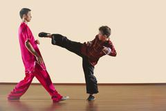 Kung Fu, Changquan, Duilian, Long Fist Style, Kung Fu instructor and boy (10-11) - stock photo