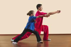 Kung Fu, Changquan, Gongbu qia hou, Long Fist Style, Kung Fu instructor and girl - stock photo