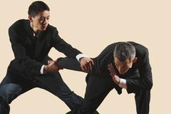 Kung Fu, Qingna duilian, Two businessmen fighting - stock photo
