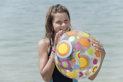 Spain, Mallorca, Girl (10-11) holding beach ball Stock Photos