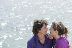 Stock Photo of Spain, Mallorca, Couple near ocean, portrait