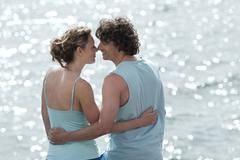 Stock Photo of Spain, Mallorca, Couple standing at ocean, embracing