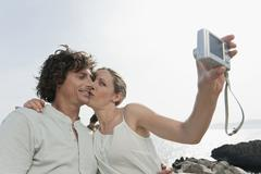 Spain, Mallorca, Couple taking self portrait Stock Photos