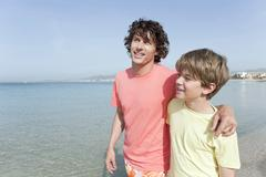 Spain, Mallorca, Father and son (8-9) on beach - stock photo