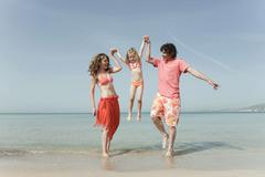 Spain, Mallorca, Family on beach, having fun - stock photo