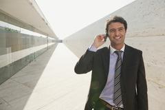 Spain, Mallorca, Businessman using mobile phone, portrait Stock Photos
