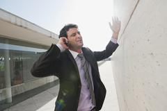 Spain, Mallorca, Businessman using mobile phone, gesturing Stock Photos