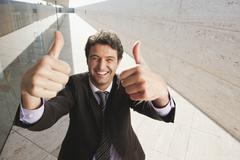 Spain, Mallorca, Businessman, thumbs up, laughing, portrait Stock Photos