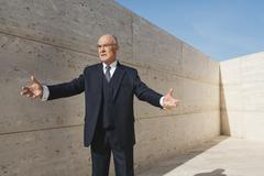Stock Photo of Spain, Mallorca, Businessman, arms outstretched