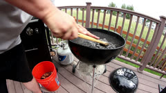 Cleaning grill getting ready for a barbeque Stock Footage