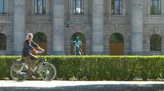 Germany Munich State Chancellery Bikers passing Bayerische Staatskanzlei Stock Footage