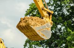 Backhoe scoop of dirt Stock Photos