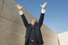 Spain, Mallorca, Businessman cheering, arms outstretched - stock photo