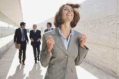 Spain, Mallorca, Business people walking together, Businesswoman in foreground - stock photo