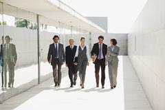 Spain, Mallorca, Business people walking together - stock photo