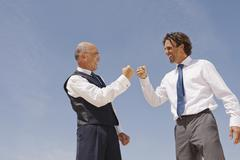 Two Businessmen rejoicing - stock photo