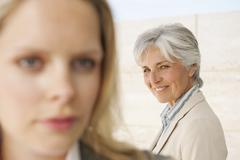 Stock Photo of Spain, Mallorca, Two businesswomen, close-up