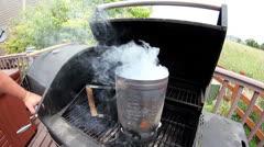 Chimney starter smoking - stock footage