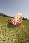 Spain, Mallorca, Boy (3-3) lying in meadow, portrait - stock photo
