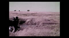 Driving across creek in expedition truck, Tanzania 1937 Stock Footage