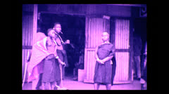 Natives outside of the Ikoma store, Tanzania 1937 - stock footage