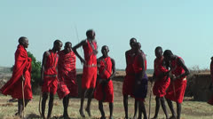 Masai Warrior dancing and singing in Manyatta in Kenya - stock footage