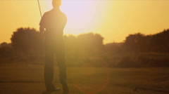 Male Golfer Sunset Silouette Following Shot - stock footage
