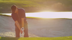 Golfer Using Sand Wedge Bunker Stock Footage