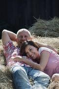 Germany, Bavaria, Couple lying on haystack Stock Photos