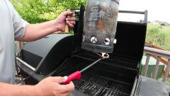 Lighting chimney starter for Backyard grilling Stock Footage