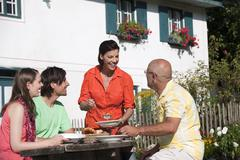 Germany, Bavaria, Friends eating in the garden Stock Photos