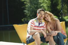 Italy, South Tyrol, Couple sitting on chair, smiling, portrait Stock Photos