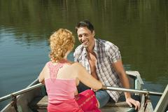 Italy, South Tyrol, Couple in rowing boat, smiling, portrait Stock Photos