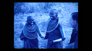 Stock Video Footage of Maasai women laughing with guide, Tanzania 1937