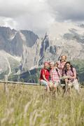 Italy, Seiseralm, Four persons looking at map, portrait - stock photo