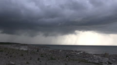 Thunderstorm over coast and ocean at faro - Sweden Stock Footage