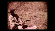 Stock Video Footage of Hunter posing with impala, Tanzania 1937