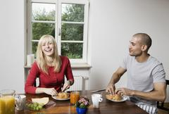 Germany, Berlin, Young couple having breakfast Stock Photos