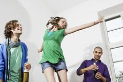 Stock Photo of Germany, Berlin, Young people at house party having fun