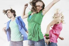 Germany, Berlin, Young people dancing at house party Stock Photos