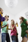 Germany, Berlin, Young people at house party Stock Photos