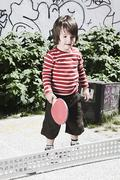 Germany, Berlin, Boy (3-4) holding table tennis racket Stock Photos