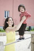 Germany, Berlin, Mother and son (3-4) at playground Stock Photos