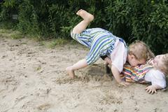 Stock Photo of Germany, Berlin, Two boys (2-3) (3-4) playing together in sandbox