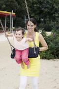Germany, Berlin, Mother and daughter (3-4) at playground Stock Photos