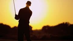 Golfer Driving Off Sunset Golf Resort Fairway - stock footage