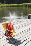 Italy, South Tyrol, Deserted deck chair on jetty Stock Photos