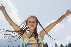 Italy, South Tyrol, Girl (13-14) with dreadlocks, cheering, portrait Stock Photos