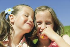 Italy, South Tyrol, Two girls (6-7) (10-11) portrait, close-up - stock photo
