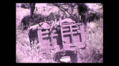 Expedition convoy crossing gully, Tanzania 1937 - stock footage